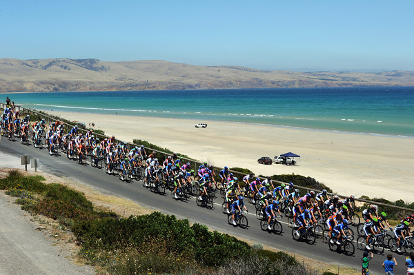 The peloton is quite relaxed as it passes Aldinga Beach on the first lap...