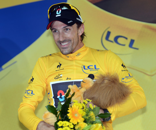 Fabian Cancellara cannot hide his delight at taking the first Yellow Jersey of the 2012 Tour de France..!