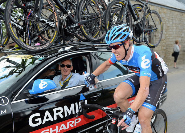 Tyler Farrar and Allan Peiper seem amused at something someone said to them...