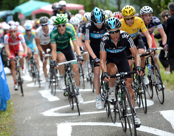 Richie Porte leads a bedraggled peloton up the steep climb about 15-minutes later...