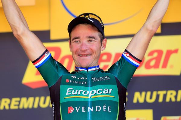 Thomas Voeckler celebrates winning stage sixteen into Bagneres-de-Luchon...