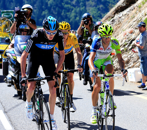 Christopher Froome is riding shotgun for Wiggins after a Nibali attack shred the favourites group...