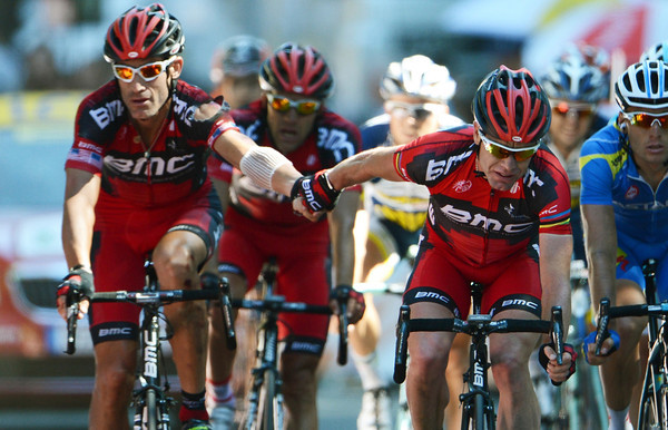 Evans finishes over eight minutes later, his arm linked with Hincapie as a way of saying 'thanks mate'...