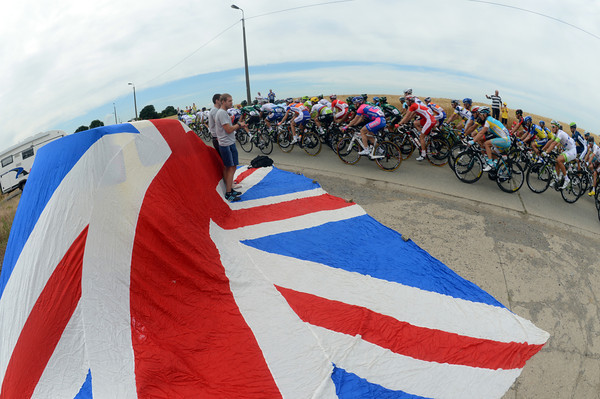 A pair of British fans display the Union Jack as the peloton breezes past in Belgium...