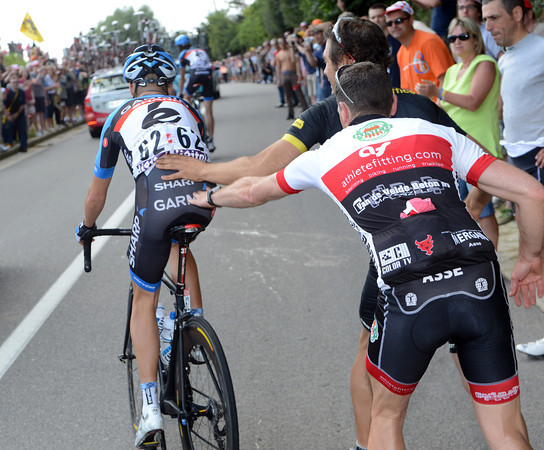 Tom Danielson needs a push from a fan after trouble with his bike on a small hill...
