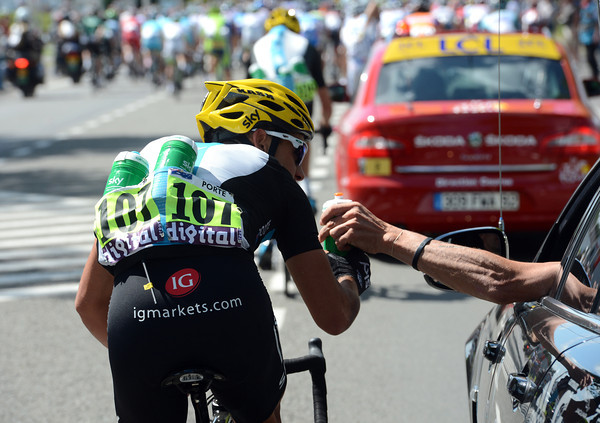 """""""One more for the road"""" - Richie Porte fills up with water bottles at the back of the peloton..."""