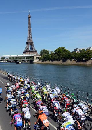 A fine sight - the peloton enters Paris alongside the River Seine and the Eiffel Tower...