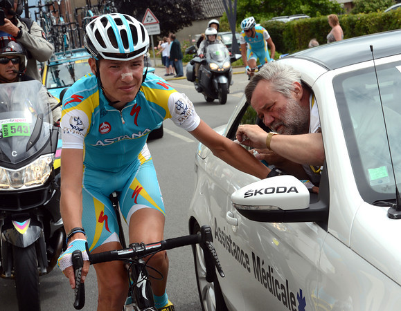 Brajkovic gets patched up by the race doctor almost a year to the day when he crashed out of the 2011 Tour...