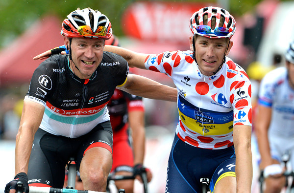 Voigt and Morkov cross the line as friends after a day-long battle in the wind and rain...