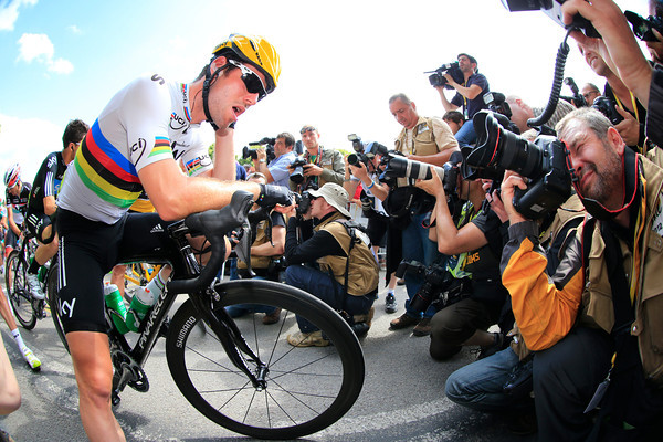 He's not camera-shy! Mark Cavendish poses for photographers before the start...