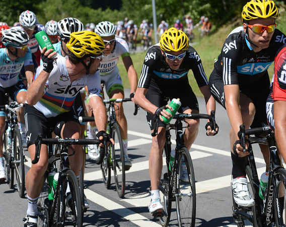 "Cavendish is off-loading his precious bottles to his teamates at the front of the race - ""anyone want a drink""..?"