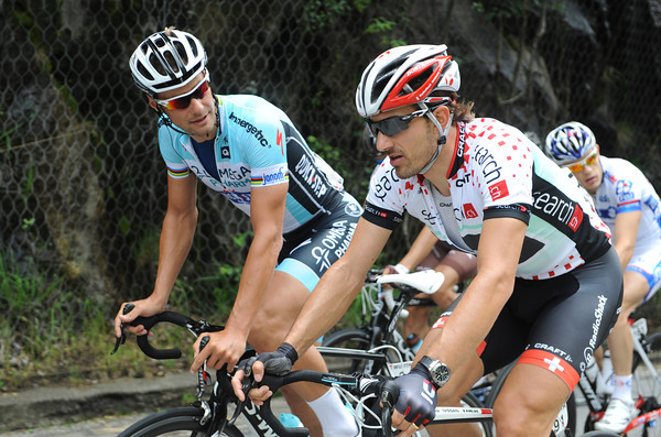 """""""Hello old freind"""" - Tom Boonen chats Classic chat with Cancellara as the road starts to climb..."""