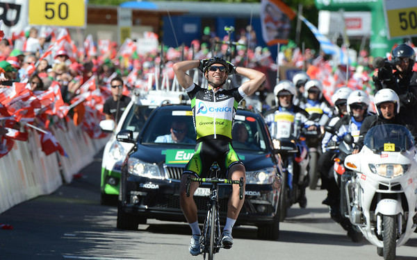 Michele Albasini wins stage eight into Arosa with a phalanx of officials and fans cheering him home..!