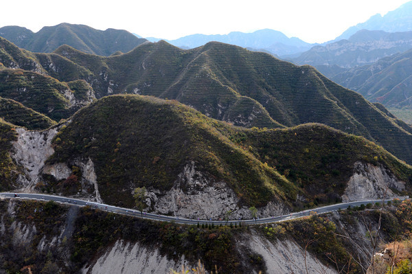 What's left of the peloton is dwarfed by the mountains in Beijing province...