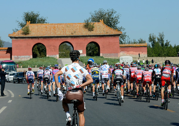 Old China - the peloton starts to race as it passes the Mink dynasty tombs...
