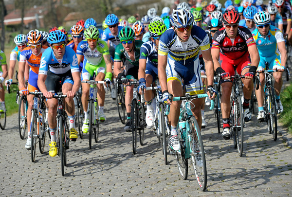 Vacansoleil lead the sedate peloton on to the Steenbeekdries - while news comes that Cancellara has crashed out of the race..!