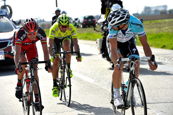 Boonen looks back at his Italian rivals - both of them very good sprinters...