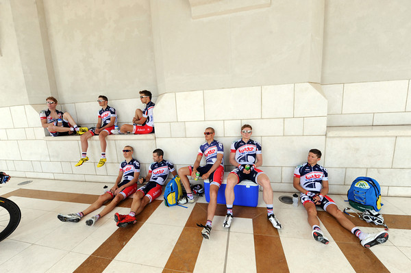 The Lotto team of Andre Greipel relax in the shade of the Al Alam Palace...