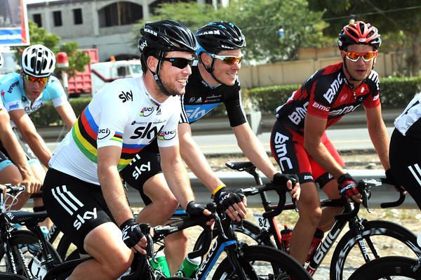 Three other riders swap jokes - Cavendish, Luke Rowe, and Adam Blythe...