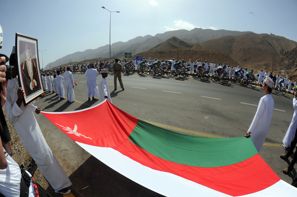 Some Omani fans cheer the race along as it passes an intersection partway through the day...