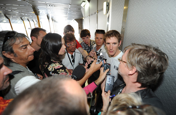 Andy Schleck is giving an impromptu press conference on the car-deck of the hydro-foil taking the race to the start...