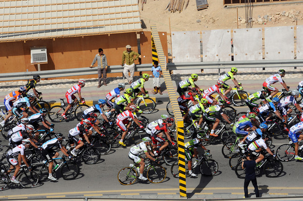 A height restriction is okay for the cyclists, but the team cars with bikes cannot get under the bar...
