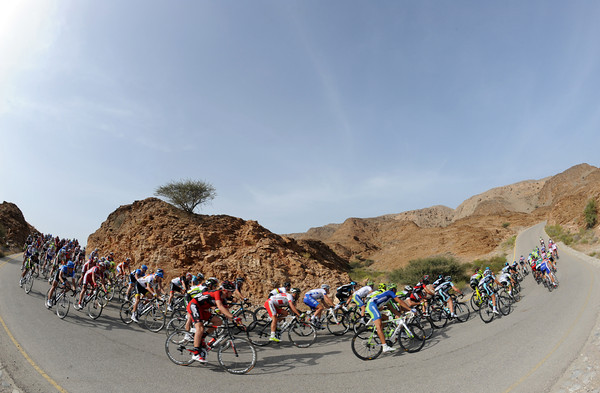 The compact peloton tackles a series of bends, descents, and climbs in a unique lunar-like landscape...