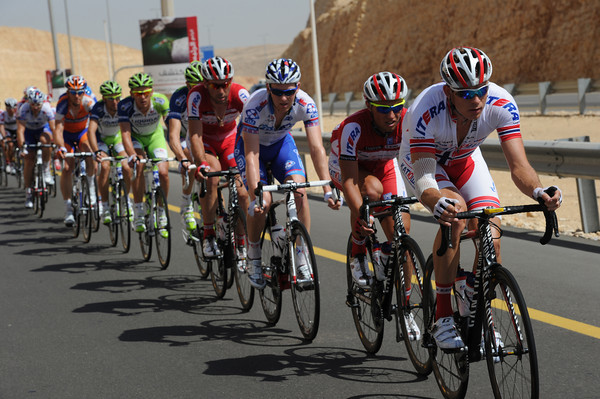 Team Katusha is already chasing at the front of the peloton...