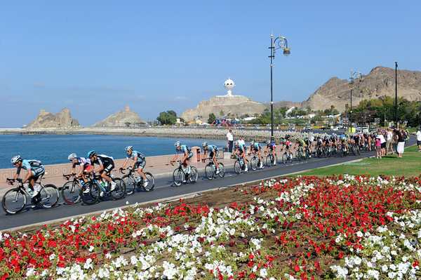 The peloton is just about together as it starts the last lap on Muscat's beautiful seafront...