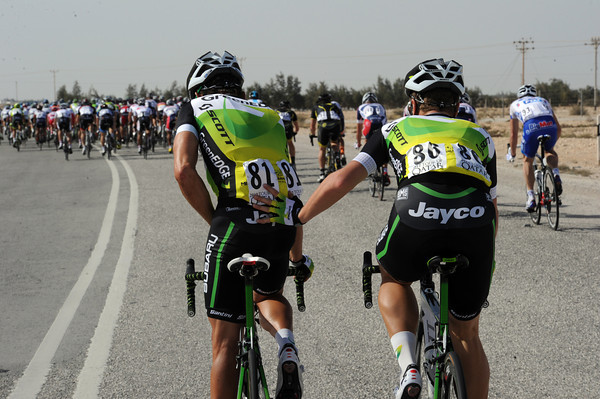 Robbie McEwen gets a helping hand from Sebastian Langeveld as the peloton starts to speed up again...