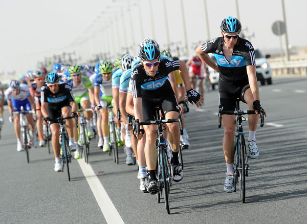 Team Sky has started a cautious pursuit, but Stannard has an easy time riding up to the front with water-bottles for Knees...