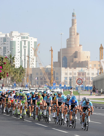 The Omega-led peloton arrives in Doha, about two minutes down on the seven escapers...