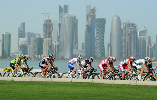 The peloton races along The Corniche, with Doha's spectacular skyline just across the bay...