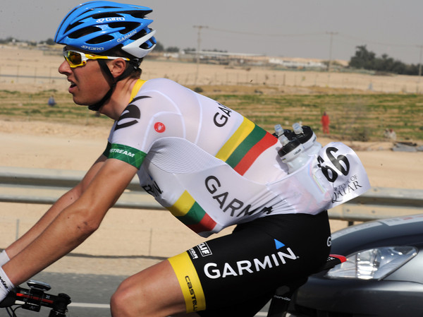 Ramounas Navardauskas has filled alll his pockets with water bottles for his teamates...