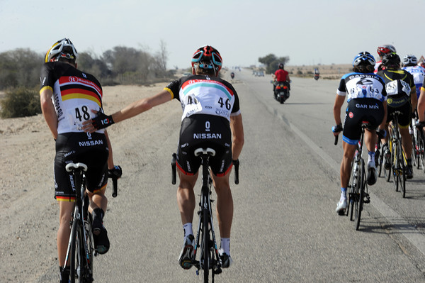 Joost Posthuma gives a helping hand to Germany's Robert Wagner as the peloton begins to speed up...
