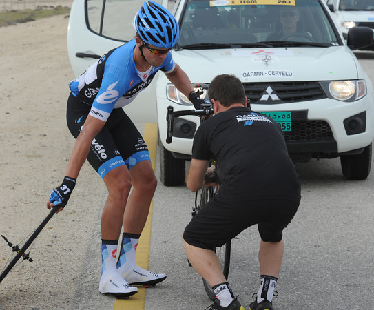 Garmin's Jack Bauer needs a wheel-change, but it has cost him a place in the fast-moving peloton...