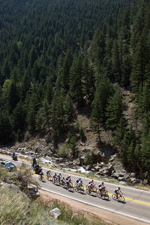 There is a fourteen man escape as the race heads up Boulder Canyon... yet again, the timeless Jens Voigt has made the break.