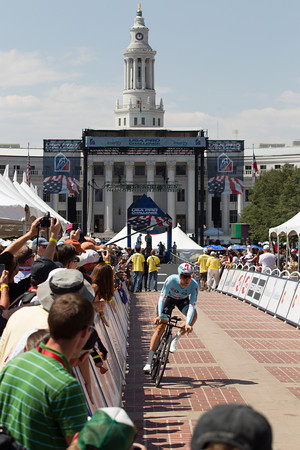 Matt Brammer rolls down the starting chute on course under sunny skies and strong crowds in Denver, Colorado.