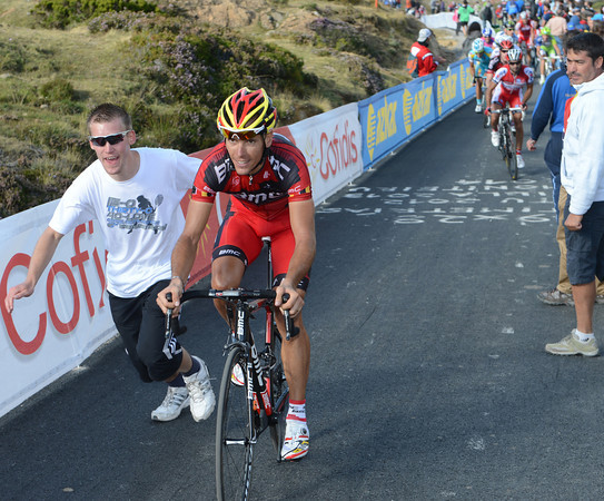 Gilbert finds it hard to resist the push of a fan, as will many other tired cyclists today...