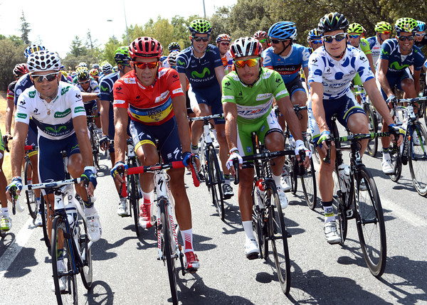 Alberto Contador, Alejandro Valverde, Simon Clarke and Joachim Rodriguez pose in their leaders' jerseys just after the start...