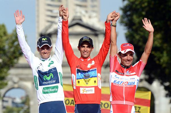 Alberto Contador shares his podium with Alejandro Valverde and Joachim Rodriguez...