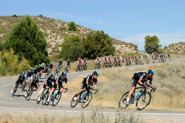 Team Sky follow Argos's pace through a corner, with Chris Froome in fourth wheel...