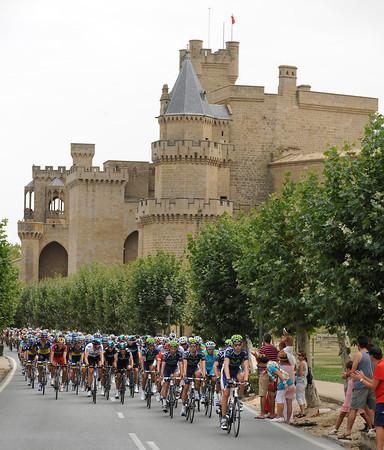 The peloton speeds past a castle somewhere in Navarra...