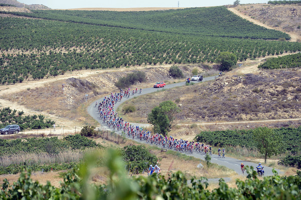 The peloton races away from the start in Rioja wine-country...
