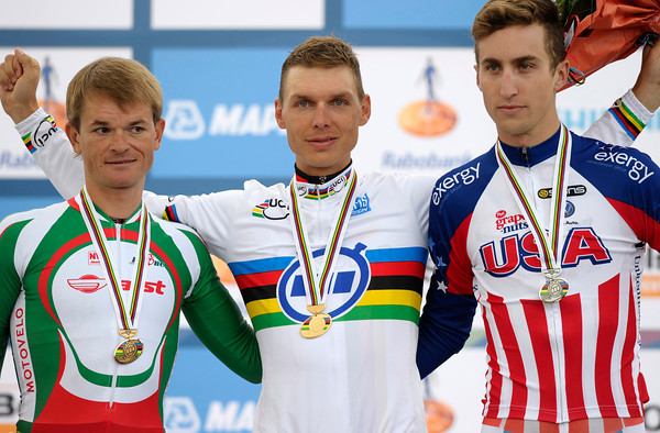 A serene Tony Martin stands next to a thoughtful Taylor Phinney and a hesitant Vasilii Kiryienka on the medal podium...