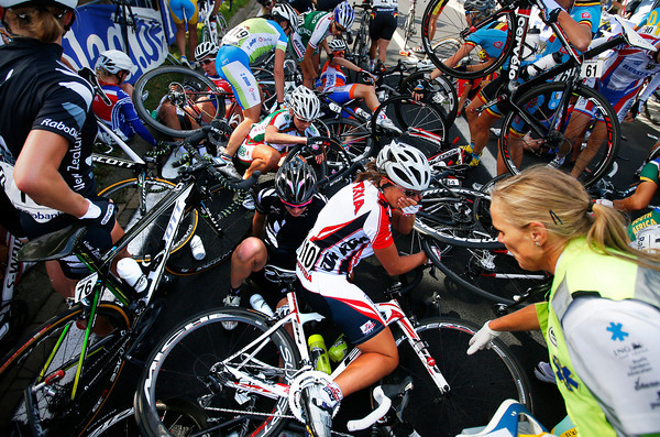 A massive crash has broken the harmony on lap two - about 30 riders are down..!