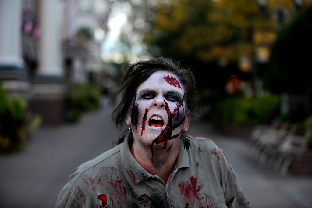 . Marie Concilio plays a zombie on the streets of Fright Fest 2013 at Elitch Gardens. Concilio and other zombies wander the park scaring passersby.   (Photo By Erin Hull/The Denver Post)