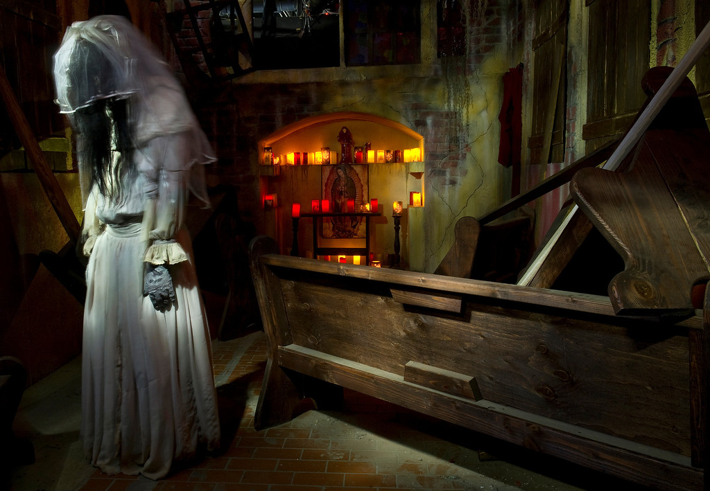 ". At the 13th Floor Haunted House in Denver, 4120 Brighton Blvd.,  on Wednesday, October 9, 2013. There are various characters on hand to scare the visitors  including ""La Llorona\""  who passes through the pews of the mission church. (Photo By Cyrus McCrimmon/ The Denver Post )"