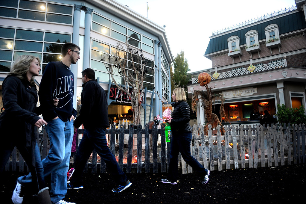 . Visitors enter the Elitch Garden\'s Fright Fest through the graveyard. Fright Fest offers visitors rides, games, zombie performances and two haunted houses.   (Photo By Erin Hull/The Denver Post)