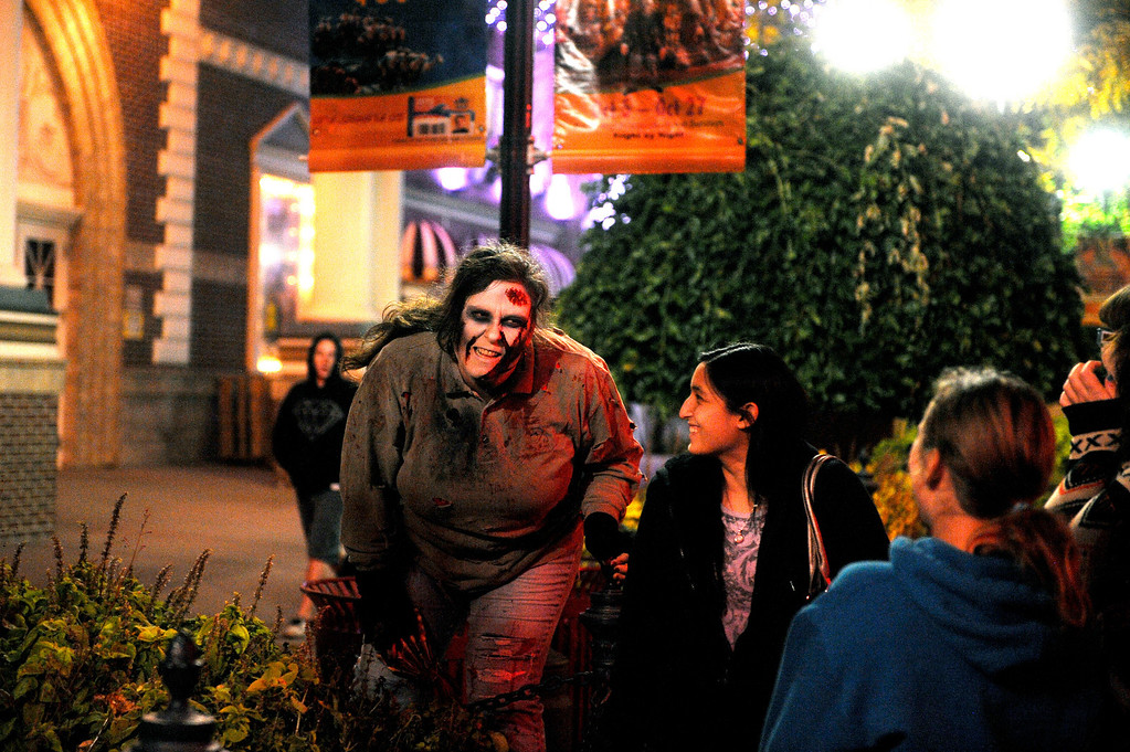 . Zombie Marie Concilio scares visitors as they walk through Elitch Gardens at Fright Fest 2013.  (Photo By Erin Hull/The Denver Post)